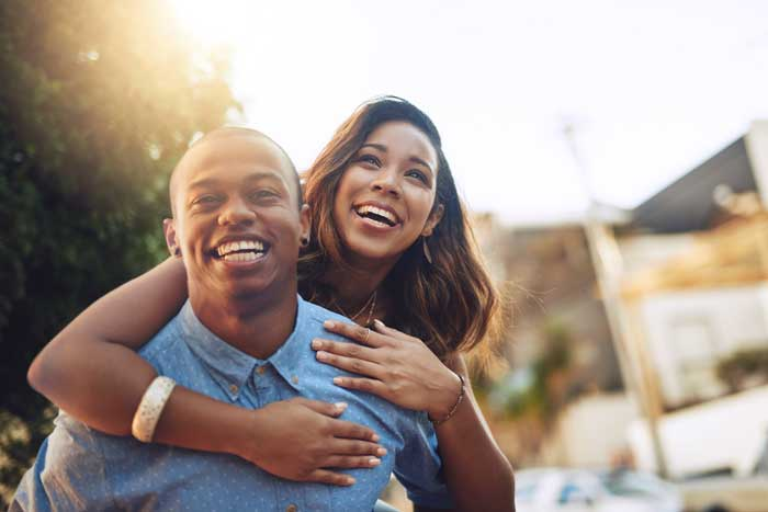 A young couple is excited to learn why they should buy life insurance in their 20s and 30s